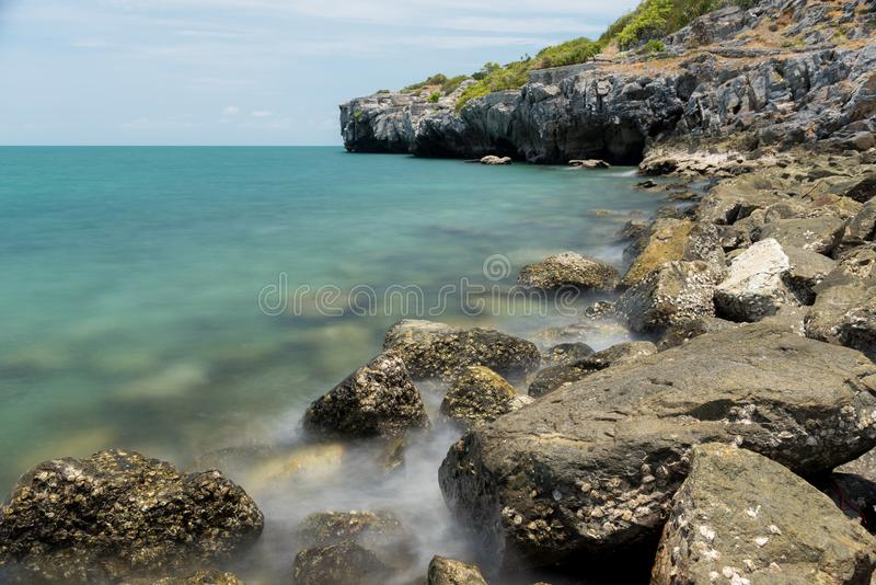 Stone in sea and wave on morning time with long exposure. Landscape stone in sea and wave on morning time with long exposure stock photography