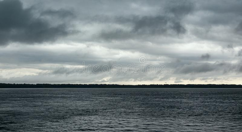 Storm clouds on the River stock photography