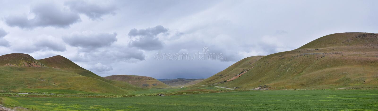 Landscape stormy panorama view from the border of Utah and Idaho from Interstate 84, I-84, view of rural farming with sheep and co. W grazing land in the Rocky stock photo