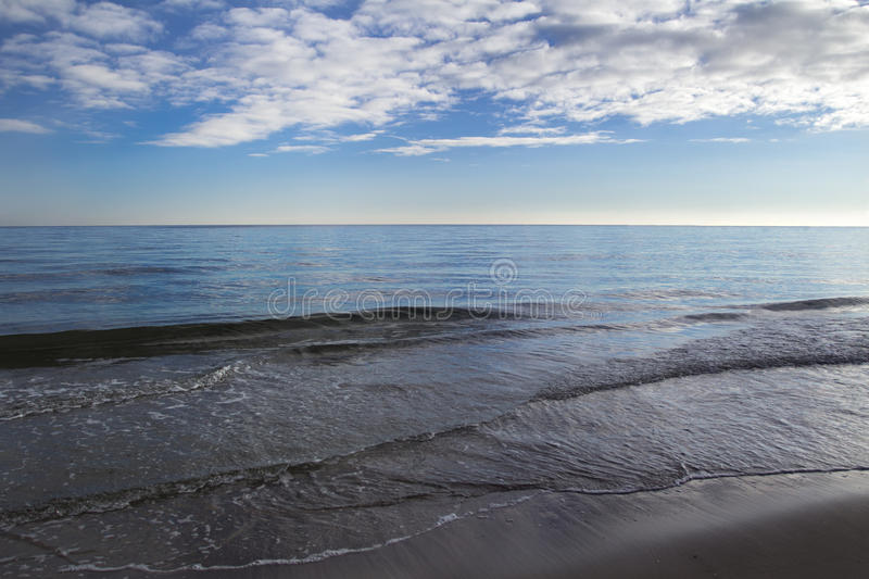 Landscape with stratocumulus clouds over horizon line. Landscape with stratocumulus clouds over sea horizon line royalty free stock photo
