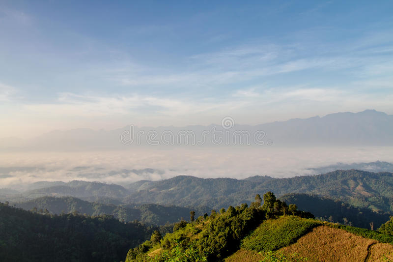 Landscape of sunrise over the mountains and the winter, fog in t stock image
