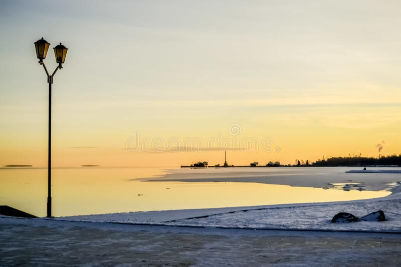 Landscape with sunrise view from the city embankment royalty free stock image