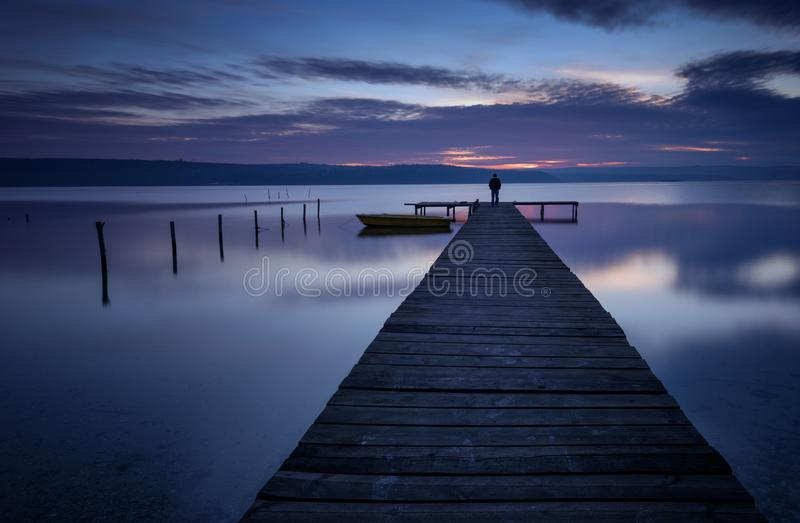 Landscape during sunset. Beautiful natural seascape, blue hour. Winter sunset at a lake coast near Varna, Bulgaria. Magnificent sunset with clouds in the stock image