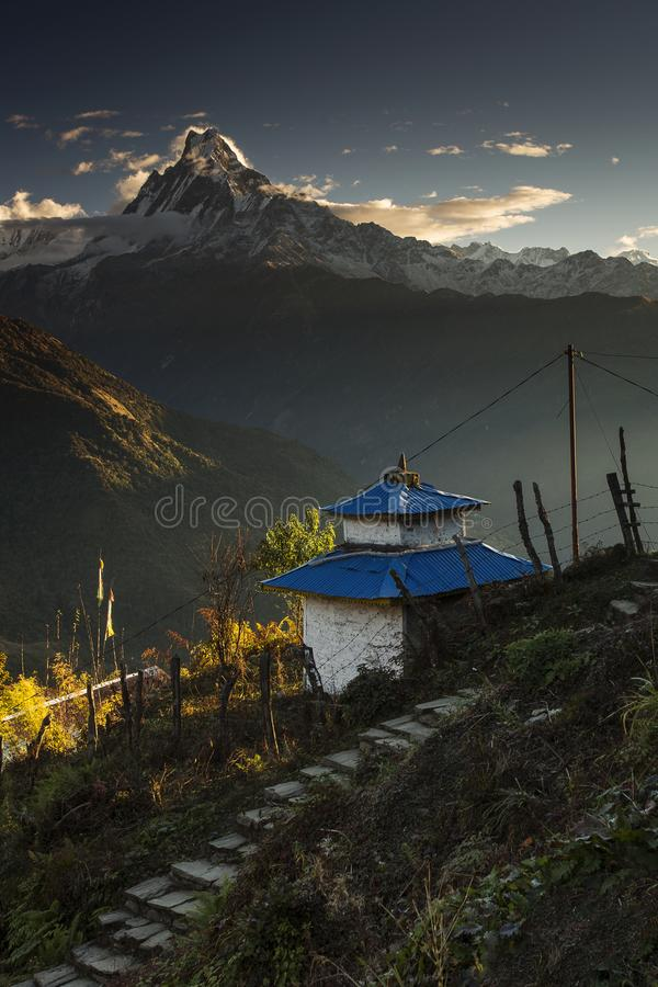 Landscape with Tadapani village on sunrise with Annapurna South, Hiunchuli and Machapuchare Fishtail Peaks in background. Himalaya stock photo