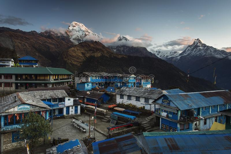Landscape with Tadapani village on sunrise with Annapurna South, Hiunchuli and Machapuchare Fishtail Peaks in background. Himalaya royalty free stock photo