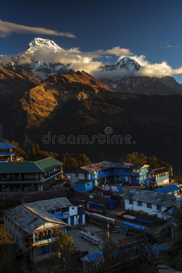 Landscape with Tadapani village on sunrise with Annapurna South, Hiunchuli and Machapuchare Fishtail Peaks in background. Himalaya stock photos