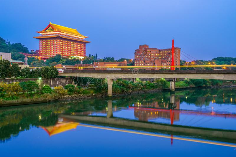 Landscape of taipei by the river with grand hotel. The Grand Hotel is a landmark located at Yuanshan in Zhongshan District, Taipei, Taiwan. The hotel was royalty free stock image