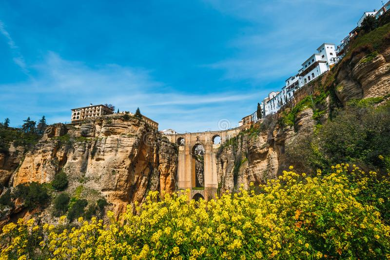Tajo Gorge and stone bridge, Ronda, Spain. Landscape with the Tajo Gorge and stone bridge, Ronda, Spain royalty free stock images