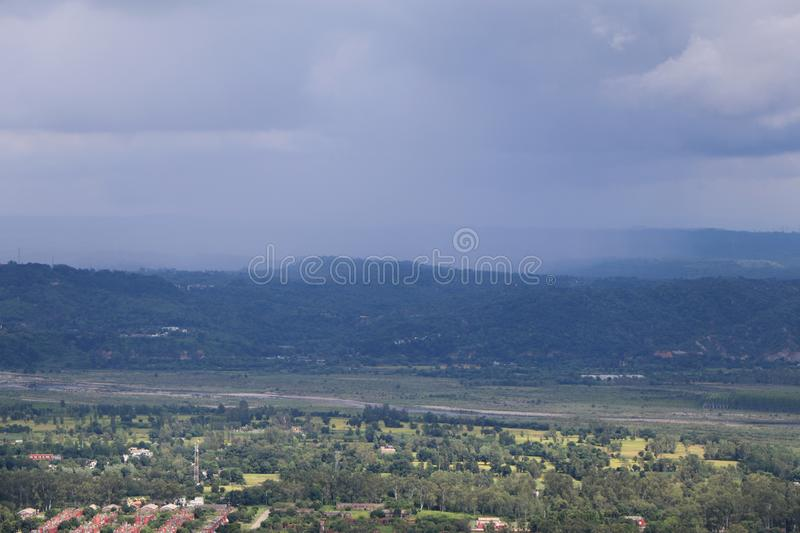 Landscape in Talwara, Punjab, India - Natural Background with Hills, Greenery and Sky. The image can also be used as a natural background stock image