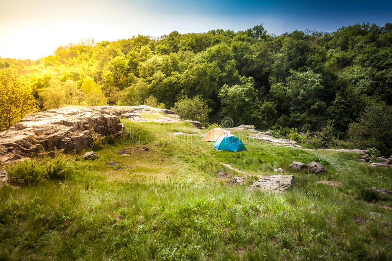 Landscape of tents on top of mountain at sunset stock photo