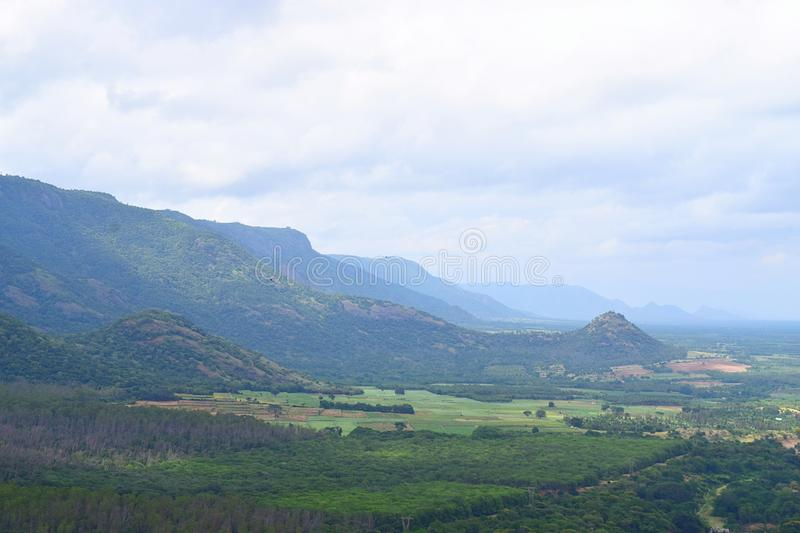 Landscape in Theni, Tamilnadu, India - Natural Background with HIlls, Greenery and Cloudy Sky. This is a photograph of a landscape in Theni, a district located royalty free stock photography