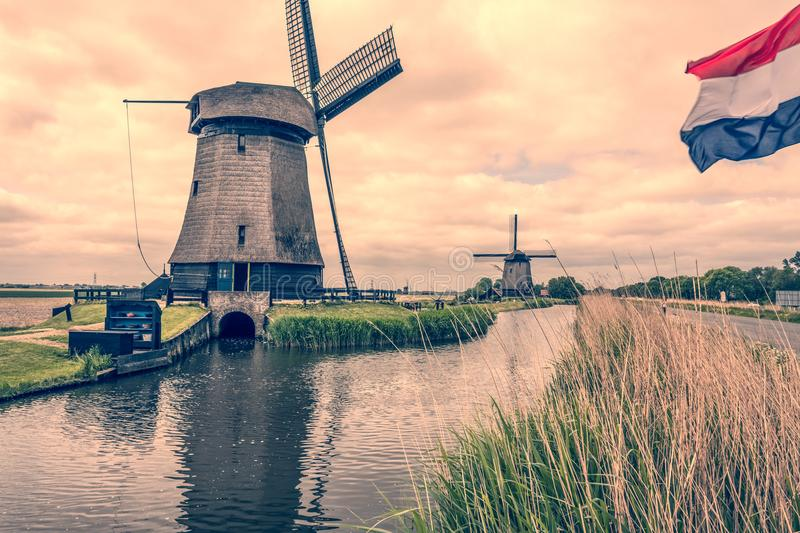 Landscape with two windmills and dutch flag. Oterleek netherlands holland stock images