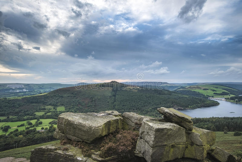 Landscape view from Bamford Edge in Peak District towards Ladybower Reservoir and Win Hill. stock photo