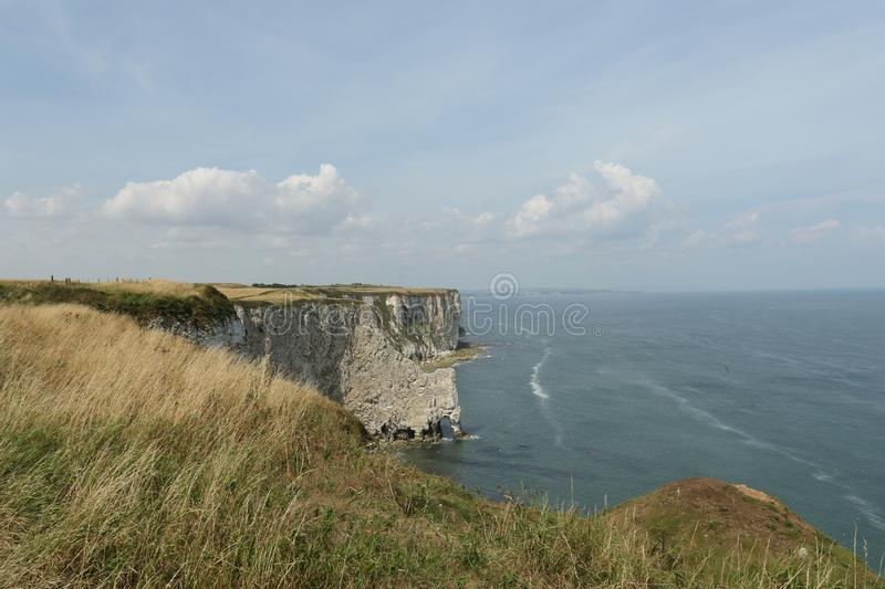 A landscape view of Bempton cliffs in Yorkshire, UK, where thousands of seabirds breed on the cliffs. A magnificent landscape view of Bempton cliffs in royalty free stock photos