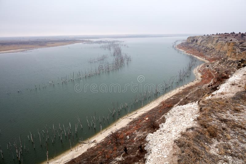 Landscape view of Cedar Bluff Reservoir. With the dead trunks of the drowned forests sticking up clear of the water on a grey day stock photo