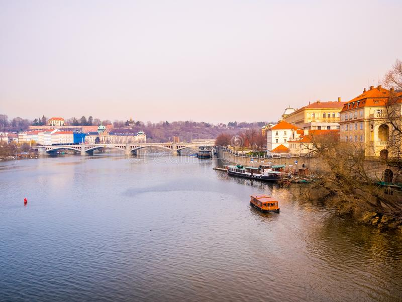 Landscape view from charles bridge with boat and ship Vltava river beautiful old town prague . czech republic. stock photos