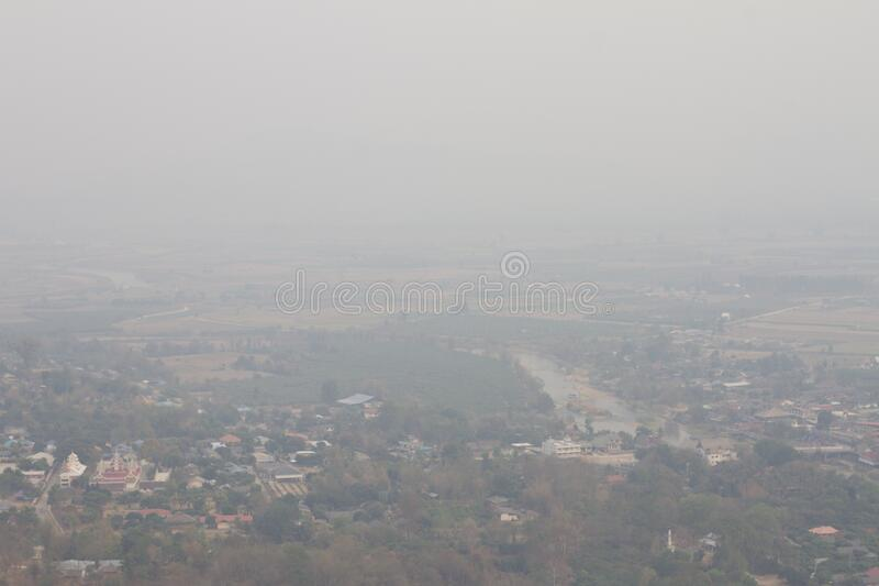 Landscape view of Chiang Mai city that showing smog and polluted air pollution from particle PM2.5. Landscape view of Chiang Mai city and skyscape that showing stock images