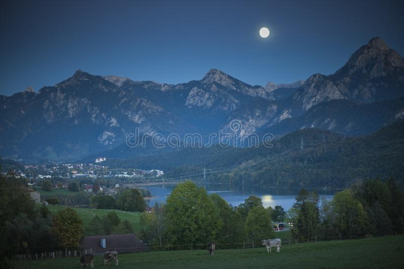 Landscape view at city Fuessen in the evening stock image