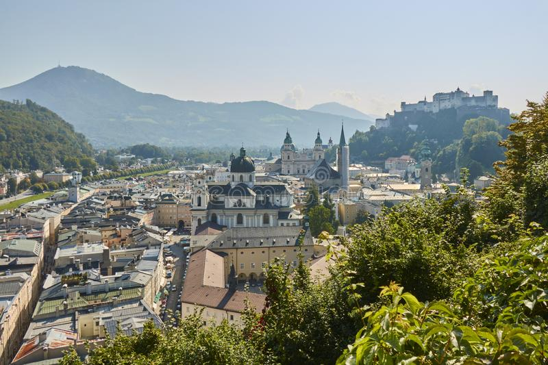 Landscape view of the city of Salzburg in Austria with a cathedral and a castle in the background. stock image