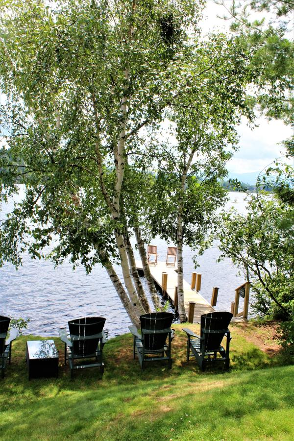 Lake Placid. Landscape view of a dock at Lake Placid, New York village and Mirror Lake royalty free stock photography