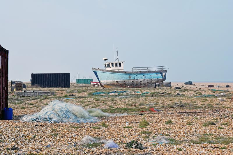 A landscape view of Dungeness a Fishing boats moored on the Pebbles stock photos
