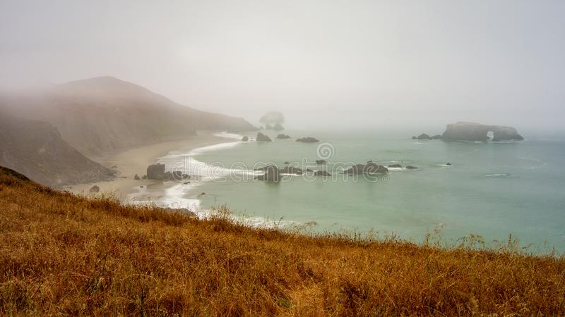 Sonoma coast on a typical foggy day. Landscape view of foggy Sonoma Coast in California, USA, by the Arch Rock beach state park on a typical summer day in the royalty free stock photo