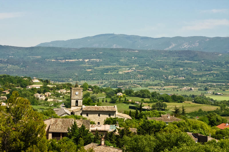 Landscape View of Goult, France. Landscape view of the homes and church of Goult, France stock photo