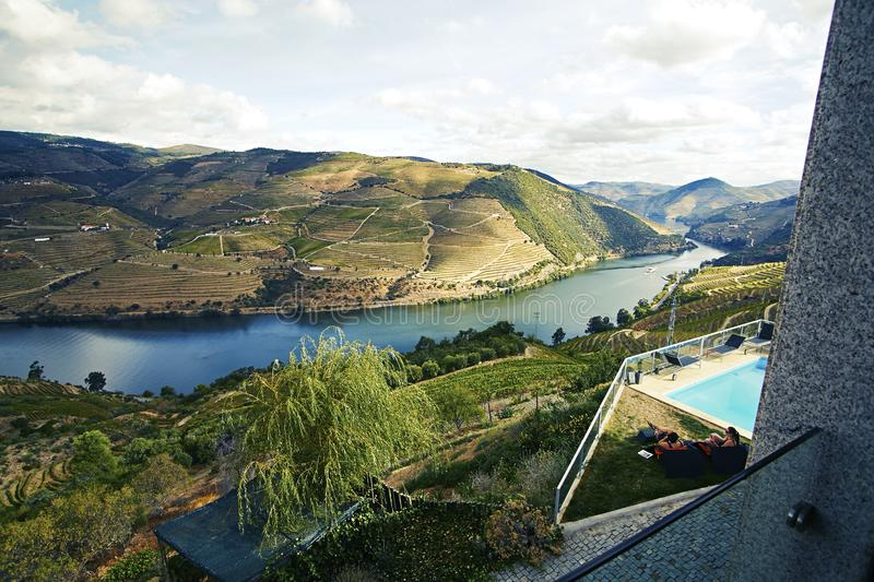 Landscape view of green valley with river and vineyard royalty free stock image
