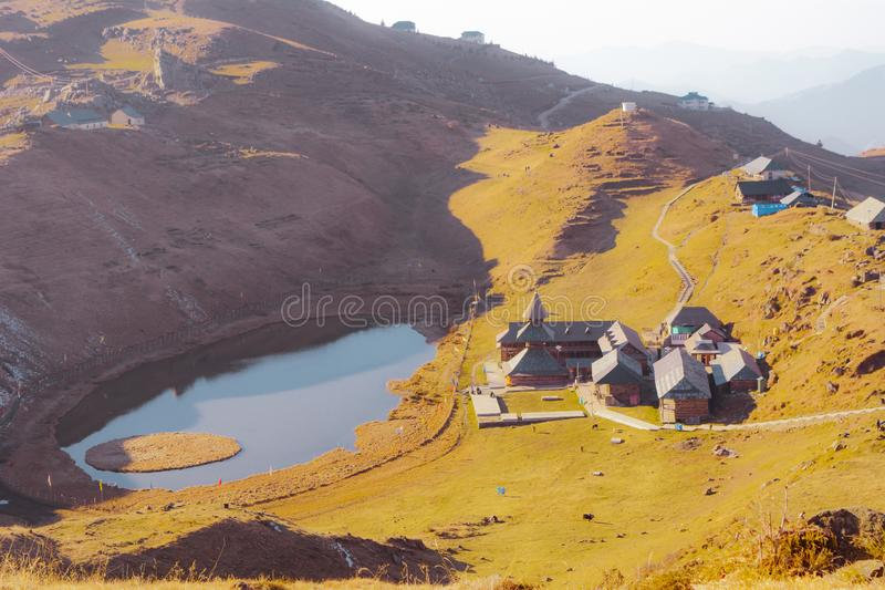 Landscape view of Lake at Top of the mountain range with wooden temple and wooden house royalty free stock images