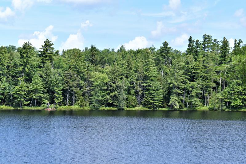 Leonard Pond, Colton,  St. Lawrence County, New York, United States. NY. US. USA. A landscape view of Leonard Pond, located near Tupper Lake in New York within royalty free stock photography