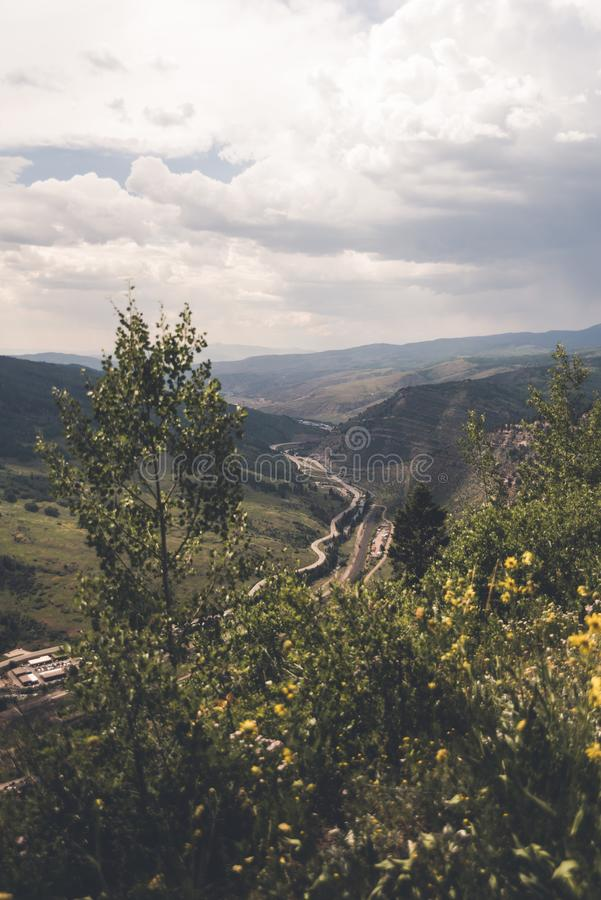 Landscape view looking over a road in Colorado. Landscape view of a valley with a road through it near Minturn, Colorado during the summer stock images