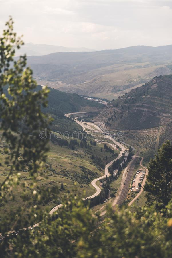 Landscape view looking over a road in Colorado. Landscape view of a valley with a road through it near Minturn, Colorado during the summer royalty free stock image