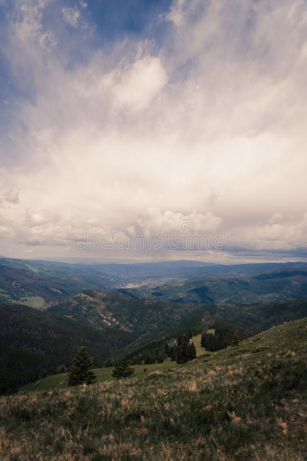 Landscape view of Minturn, Colorado with storm clouds overhead. Landscape, scenic view of Minturn, Colorado in the summer with storm clouds rolling in stock photo