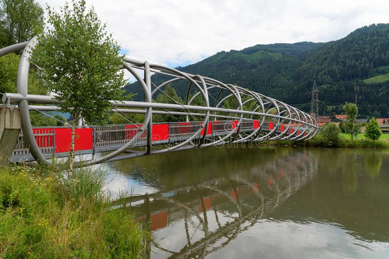 Modern bridge over the river Mur or Mura in Austria. Landscape view and a modern bridge over the Mur river in Austria. The Mur or Mura is a river in Central stock photography