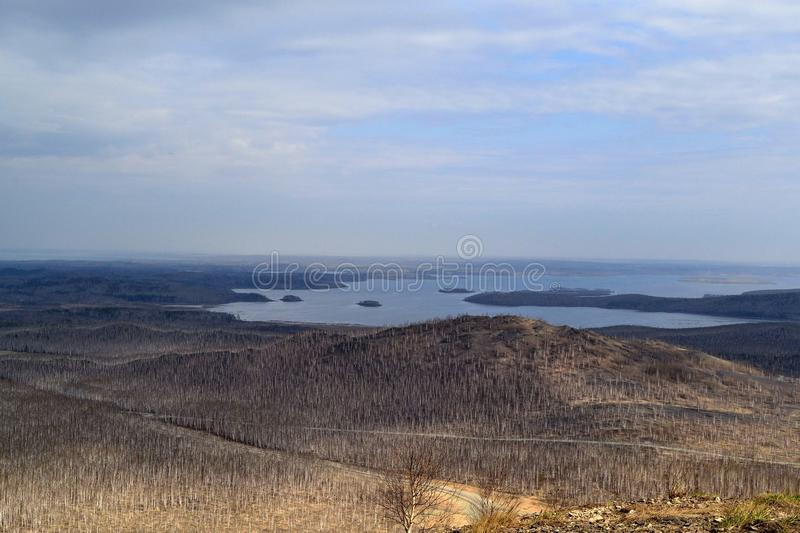 Landscape. View from the mountain. Karabash, Russia. Sky, lake, water, horizon royalty free stock photography
