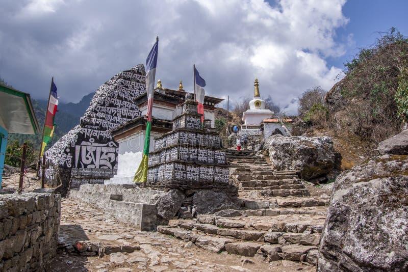 Landscape view of mountain path splitting around stone royalty free stock photos