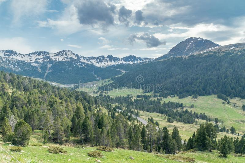 Landscape view with mountains covered in snow in Andorra at summer time stock photo