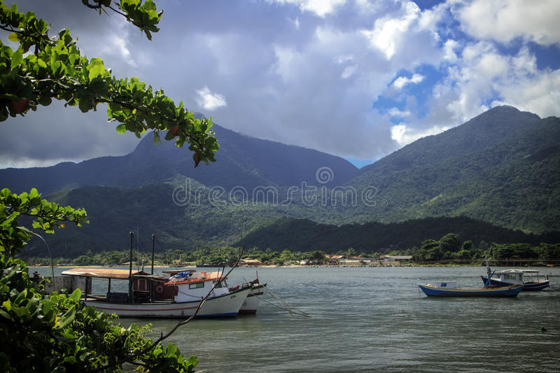 Landscape View of Mountains and Sea with Boats in the Foreground. Ilhabela Sao Paulo, Brazil. Boats on the water with mountains that meet the sea in the royalty free stock images