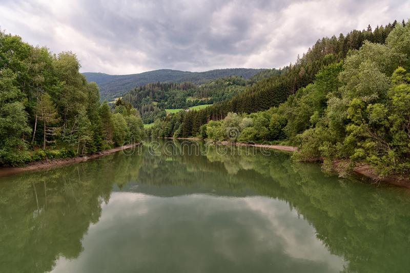 Landscape view of the river Mur or Mura, Austria. Landscape view of the Mur river in Austria. The Mur or Mura is a river in Central Europe rising in the Hohe royalty free stock photos