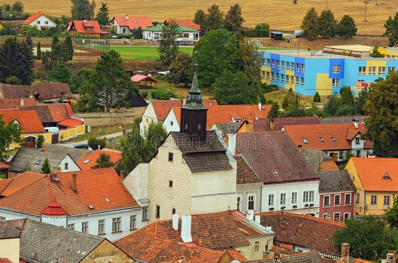 Landscape view of old colorful buildings with red tile roofs in medieval town. Slavonice, Czech Republic.  royalty free stock photo