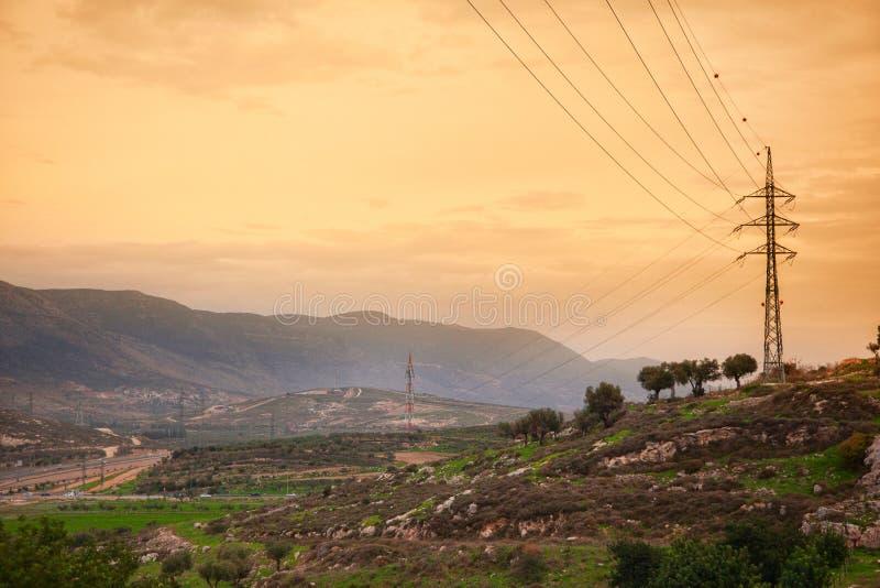 High voltage power lines at sunset. Landscape view with power lines at sunset stock image