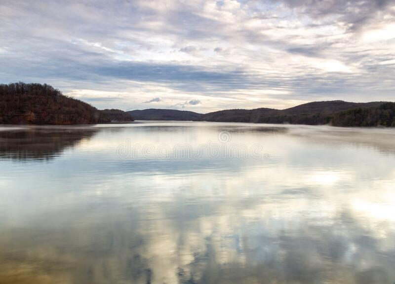 Croton-On-Hudson,  NY / United States - Jan 12, 2020: view of the New Croton Dam. A landscape view of the reservoir at sunrise with clouds and reflections stock photos