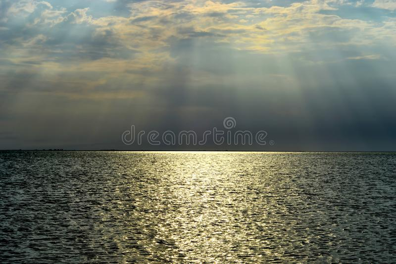 Landscape view of the setting sun over the sea royalty free stock image