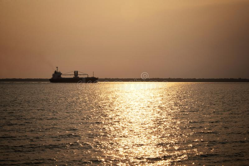 Landscape view before sunset in the sea Sun light Reflect the sea Cargo Ship. Landscape view before sunset in the sea Sun light Reflect the sea Cargo Ship royalty free stock image