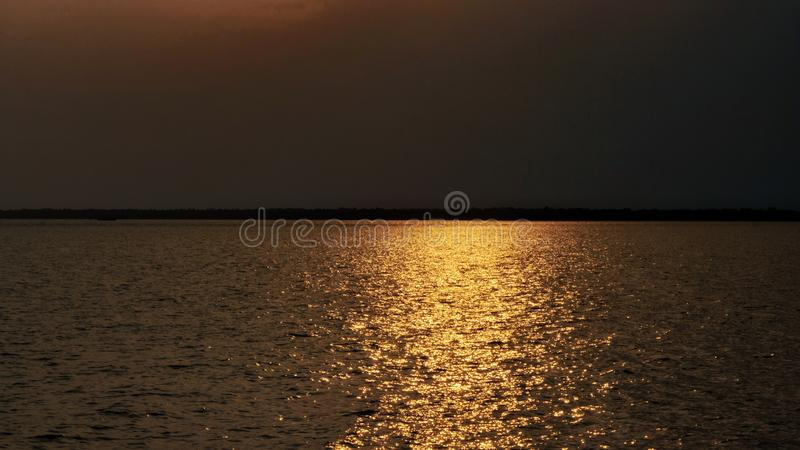 Landscape view before sunset in the sea Sun light Reflect the sea.  royalty free stock photography