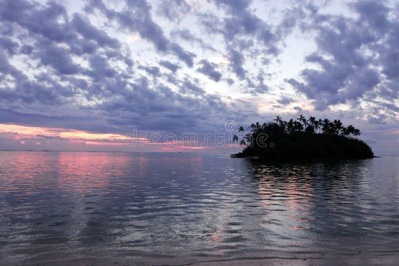 Taakoka islet at dusk Muri lagoon Rarotonga Cook Islands royalty free stock image