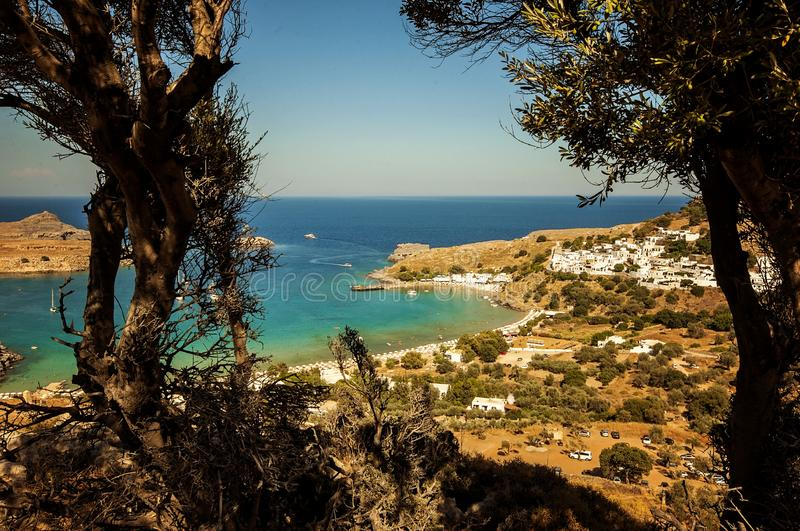 A landscape view to a little village Lindos in Rhodes, Greece. A landscape view to a little village Lindos in Rhodes Greece royalty free stock images
