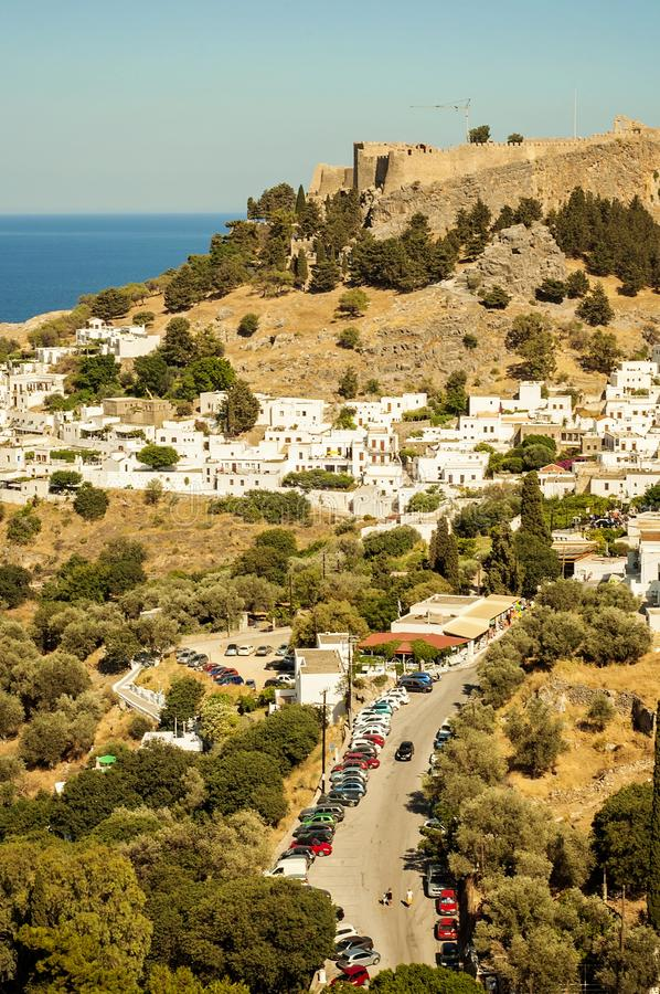 A landscape view to a little village Lindos in Rhodes, Greece and an old castle on the background. A landscape view to a little village Lindos in Rhodes Greece royalty free stock photo
