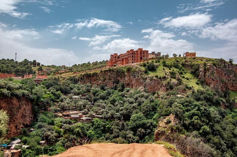 Landscape view of touristic area waterfall with hotel complex on the top of the area, Ouzoud Falls. Moyen Atlas village of. Tanaghmeilt, Atlas mountains stock photos