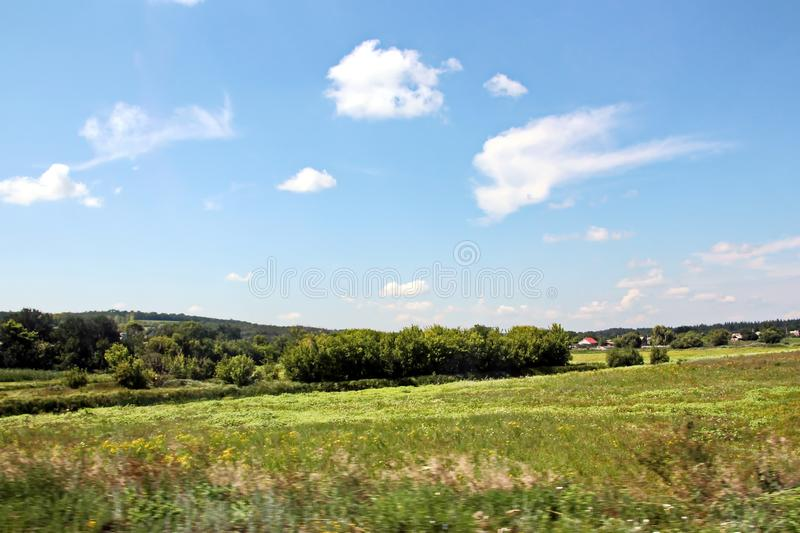 Landscape views of nature, fields, villages and roads of Ukraine. View from the car window when driving. royalty free stock photo